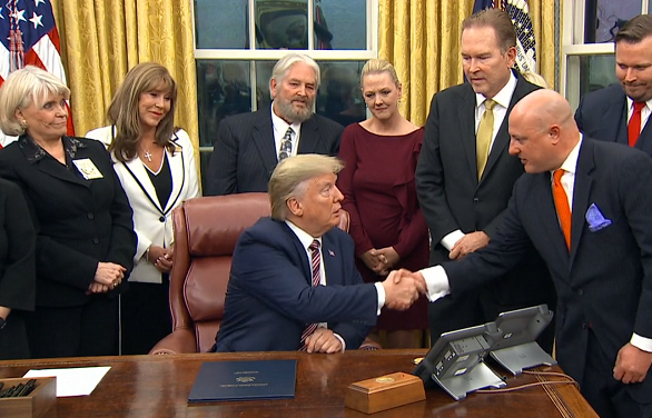 President Trump shaking hands with Animal Wellness Action's Executive Director  Marty Irby at last night's signing ceremony in the Oval Office