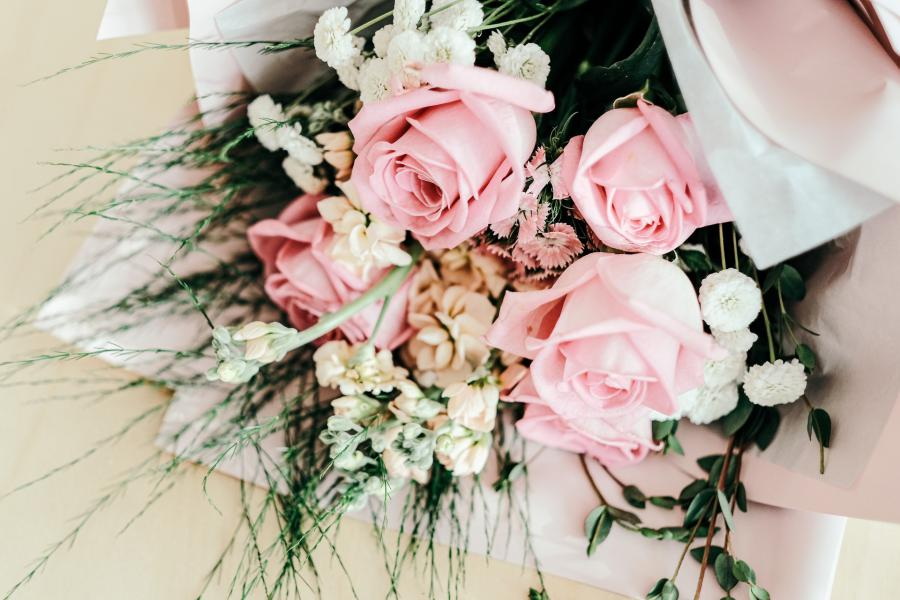 Light pink floral bouquet and delicate greens.