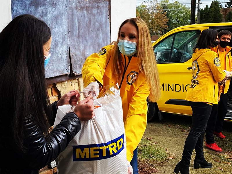 Volunteer Ministers distribute food, hand sanitizer and cleaning supplies to 653 at-risk residents of the town.