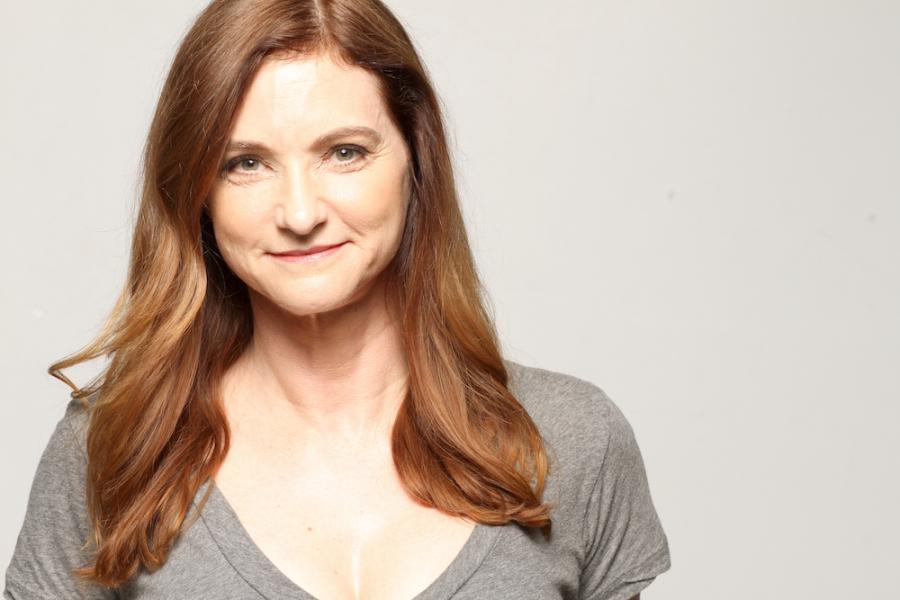 Lori Hamilton  creator, writer, performer, redhead woman in casual shirt