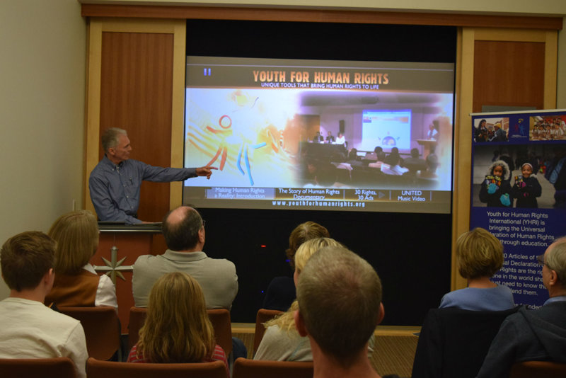 Director of the Youth for Human Rights International Twin Cities chapter informed guests about what they can do to help victims of human trafficking.