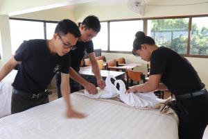EGBOK students in training, making bed