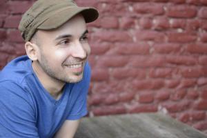 Dan dos Santos posing with a cap on