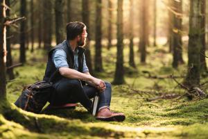 A solo traveler enjoying coffee in the Scandinavian nature
