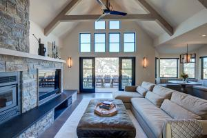 A beautifully designed and built great room with exposed beams and a view overlooking Lake Sonoma; designed and built by the team at LEFF Construction Design Build, Sebastopol, CA