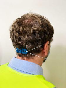 Detectable Reusable Ear Saver on Person