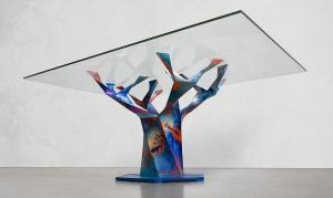 A view of painter Chris Trueman's interpretation of Edenic Design's Teâshí Coffee Table. His layering technique uses spray cans, brushes and squeegees to create a piece that is immersive whether seen from afar or close, with details that resemble nebulas in space.