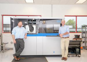 Steve Rengers (left) and Greg Morris of Vertex Manufacturing stand by their Concept Laser M2 DMLM machine.