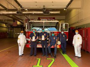 Church volunteers in PPE delivering Stay Well booklets to a fire station