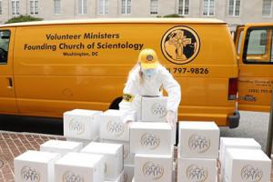 Several thousand Stay Well booklets being distributed by Church of Scientology volunteer