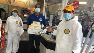 Convenience store owner receives Stay Well booklets