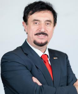 A portrait business photo of Dr. Florian Kongoli who was Honored with the Title of Honorary Citizen of Rio de Janeiro