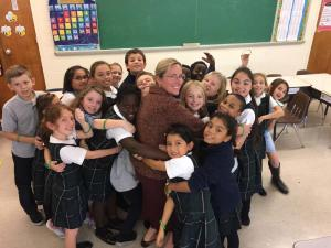 Scarlett Lewis with class of students group hug