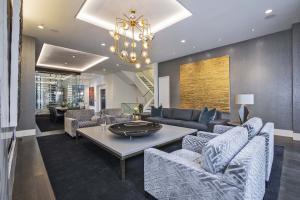 An elegant and spacious Uptown residence with views of downtown.