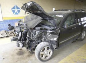 Wrecked SUV in Brain Injury Settlement