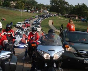"""Church volunteers joined forces with Councilman for the 3rd District at-Large Brandon Ellington in a """"Peace Ride."""""""