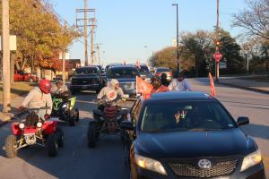 Motorbikes and 4-wheelers, cars and SUVs ride through the streets of Kansas City with their message of peace.