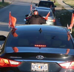 Bright orange flags signal participation in the second bimonthly KC Peace Ride.
