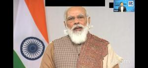 A Zoom screenshot of PM Modi is shown with an icon of conference chair.