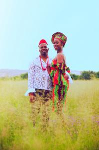 Singer Elle B with husband and collaborator, Kelechi A. pose in field in traditional Nigerian clothing