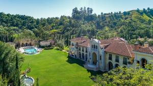 A walking/jogging trail meanders the perimeter of the estate and its sweeping four plus-acre, exceptionally manicured backyard.