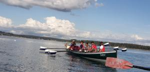 UPG Sustainability Leaders in a small rowing boat together