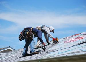 roofers working on a roof installation in RI