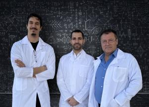 Three members of ADGS team front of the blackboard showing equations