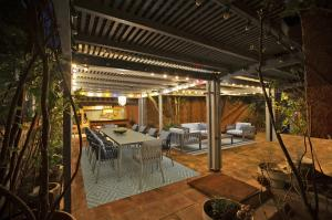 The lush landscape of the property between the three houses gives an extra air of privacy while indoors and out.