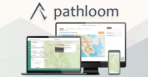 Pathloom app on multiple digital device screens with abstract mountain background underlay