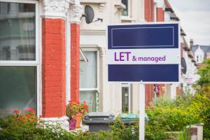 Let and managed sign displayed outside a terraced house in Harringay Ladder area, London