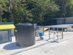Roof-mounted water tank on concrete roof