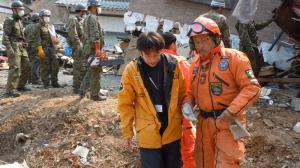 """os Topos founder and president Hector """"Chino"""" Mendez (right), with lead Japanese Scientology Volunteer Minister as interpreter, coordinated with the military in the aftermath of the 2011 Japan earthquake and tsunami."""
