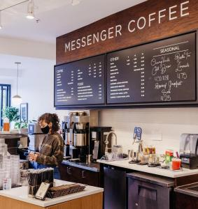 Photo showing the interior of a new Messenger Coffee cafe opening on Kansas City's Country Club Plaza on May twelth, twenty-twenty one.