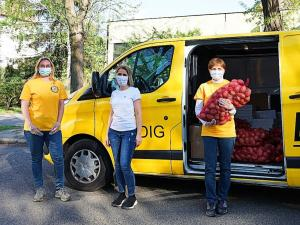 Their bright yellow van was filled with Mother's Day gifts and bags of potatoes, onions and other durable food.