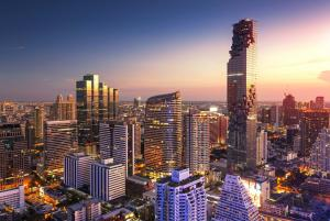 The building spirals up within the Bangkok skyline, iconic and inviting from first look.