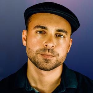 Headshot of Ben Barbic wearing a black cap.