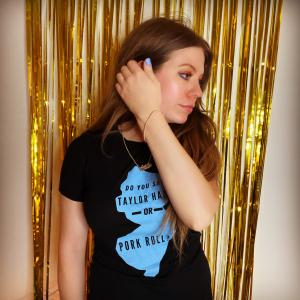 """Amy Jans wearing a t-shirt from the """"Jestful Jersey"""" collection from the I Don't Have a Niche Etsy Shop."""