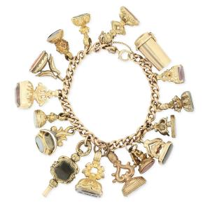 Victorian intaglio seal charm bracelet, 9kt to 18kt gold, with 16 charms, including a 9kt gold cigarette holder and a pocket watch key (CA$4,425).