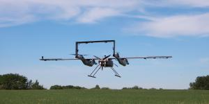 A Pegasus Imagery PV-02 EOS lifts off for takes off vertically like a quadcopter before transitioning to horizontal flight. The PV-02 Eos is a fixed-wing class III VTOL RPAS