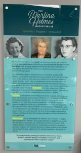 Wall display plaque describing the mission of The Martina Holmes Innovation Lab with three pictures of Martina Holmes at different ages.