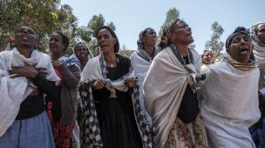 Women mourn after massacre in Dengolat, Tigray, February, 2021