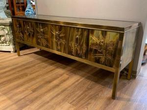 Just delivered, a Bernhard Rohne credenza for Mastercraft in engraved bronze with a brass panel top on three pairs of hinged doors.  Estimate: $ 3,000 to $ 5,000.