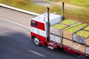 The image is of an agricultural truck delivering produce.