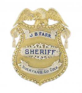 J.B. Farr's early 1900s 14kt gold presentation sheriff's badge, highly detailed, an important piece of Colorado history ($22,420).