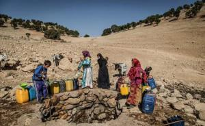 July 25, 2021 - A group of villagers are gathered near a well to take water for their homes.