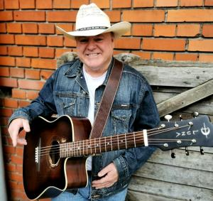 """Doug Adkins with Guitar for """"A Cowboys' Life"""" CD Review"""