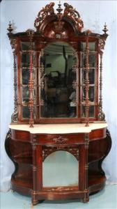 Rosewood Victorian etagere with a bonnet crown and white marble top, 8 feet 3 inches tall (estimate: $2,500-$3,500).