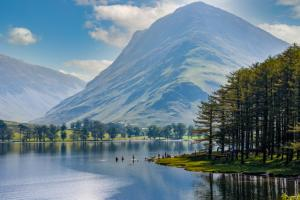 Buttermere Lake surrounded by a green hill in the Lake District in England