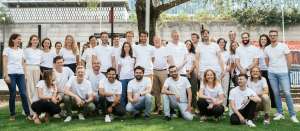 A group photo of the CitizenLab team standing together outdoors